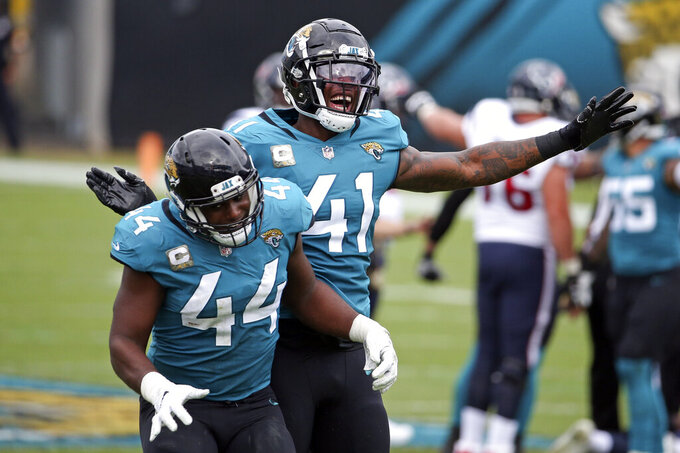 Jacksonville Jaguars linebacker Myles Jack (44) and linebacker Josh Allen (41) celebrate after the Jaguars recovered a Houston Texans fumble during the first half of an NFL football game, Sunday, Nov. 8, 2020, in Jacksonville, Fla. (AP Photo/Stephen B. Morton)