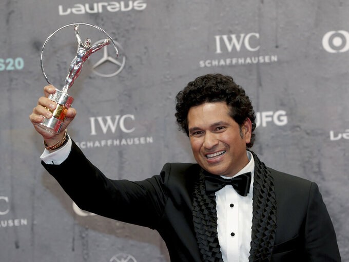 FILE - In this Monday, Feb. 17, 2020 file photo, Sachin Tendulkar poses with the 'Best Sporting Moment Award' during the 2020 Laureus World Sports Awards in Berlin, Germany. Indian cricket great Sachin Tendulkar has tested positive for the coronavirus and is quarantining at home, it was announced Saturday, March 27, 2021. The 47-year-old Tendulkar is test cricket's all time leading run-scorer.  (AP Photo/Michael Sohn, file)