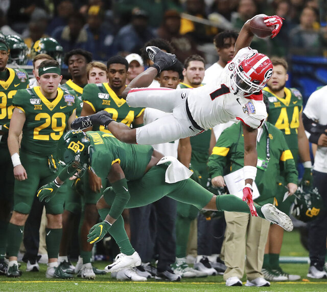 Georgia wide receiver George Pickens makes a catch over Baylor safety Grayland Arnold during the first half of the Sugar Bowl NCAA college football game Wednesday, Jan. 1, 2020, in New Orleans. (Curtis Compton/Atlanta Journal-Constitution via AP)