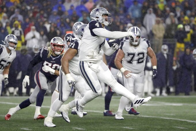 Dallas Cowboys quarterback Dak Prescott follows through on a pass under pressure from New England Patriots defensive end Chase Winovich, left, in the second half of an NFL football game, Sunday, Nov. 24, 2019, in Foxborough, Mass. (AP Photo/Elise Amendola)