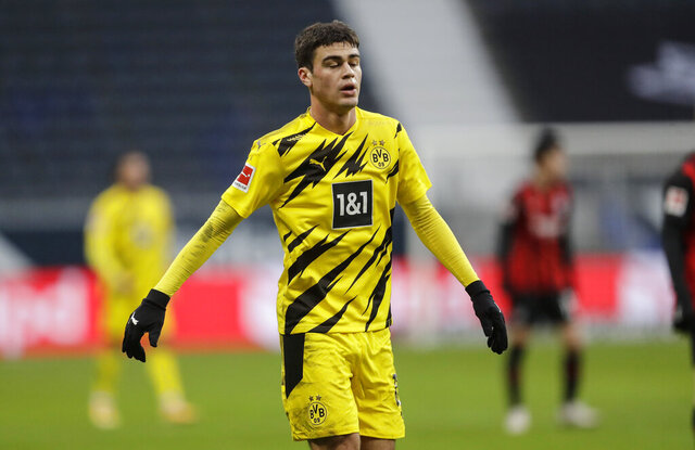 Dortmund's Giovanni Reyna reacts during the German Bundesliga soccer match between Eintracht Frankfurt and Borussia Dortmund in Frankfurt, Germany, Saturday, Dec. 5, 2020. (AP Photo/Michael Probst, Pool)