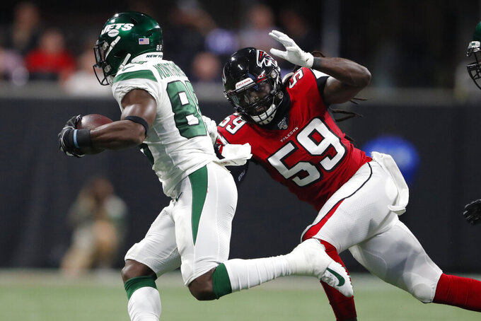 New York Jets running back Ty Montgomery (88) runs past Atlanta Falcons outside linebacker De'Vondre Campbell (59) during the first half an NFL preseason football game, Thursday, Aug. 15, 2019, in Atlanta. (AP Photo/John Bazemore)