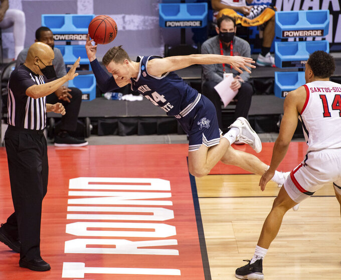 Utah State forward Justin Bean (34) attempts to save the ball from going out-of-bounds during the second half of a first round game against Texas Tech in the NCAA men's college basketball tournament, Friday, March 19, 2021, at Assembly Hall in Bloomington, Ind. (AP Photo/Doug McSchooler)