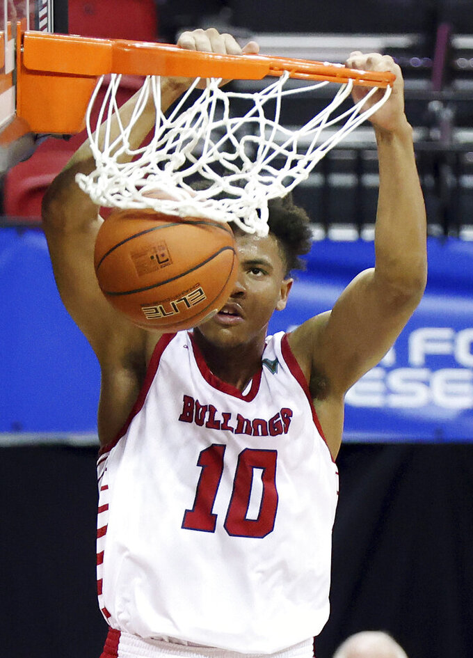 Fresno State forward Orlando Robinson dunks against New Mexico during the second half of an NCAA college basketball game in the first round of the Mountain West Conference men's tournament Wednesday, March 10, 2021, in Las Vegas. (AP Photo/Isaac Brekken)