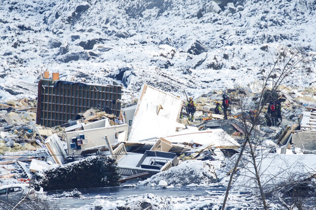 Rescue work continues after the large landslide that destroyed several houses at Ask in Norway, Tuesday, Dec. Jan 5, 2021.  Several homes were taken by the landslide early Wednesday Dec. 30, killing seven people, while three are still reported missing. (Terje Pedersen / NTB via AP)
