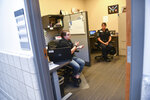 Community Crime Impact Team Mental Health Responders Kenzie Janson-Wolle, left, and Kelly Holden talk about their work during an interview Monday, July 13, 2020, at the St. Cloud, Minn., Police Department. (Dave Schwarz/The St. Cloud Times via AP)