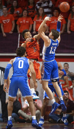 Virginia Tech guard Wabissa Bede (3) blocks a shot by Duke forward Joey Baker (13) during the first half of an NCAA college basketball game Friday, Dec. 6, 2019, in Blacksburg, Va. (AP Photo/Don Petersen)