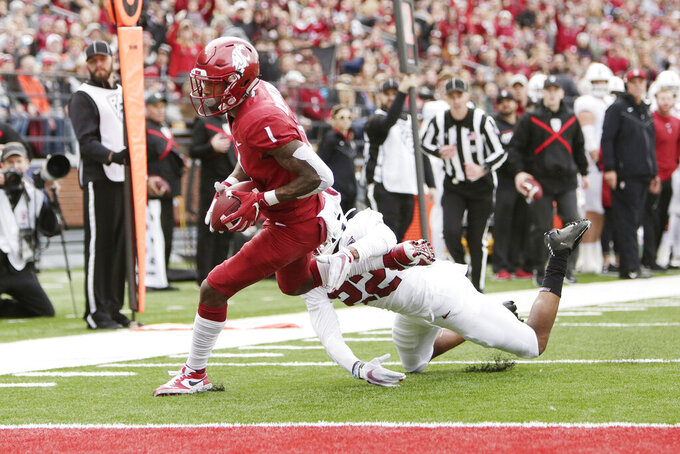 Washington State wide receiver Davontavean Martin, left, runs for a touchdown while pressured by Stanford cornerback Obi Eboh during the first half of an NCAA college football game in Pullman, Wash., Saturday, Nov. 16, 2019. (AP Photo/Young Kwak)