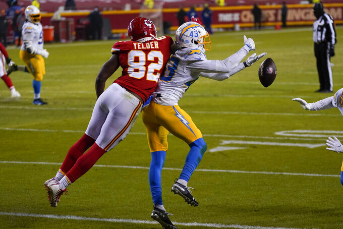 Los Angeles Chargers cornerback Michael Davis (43) breaks up a pass intended for Kansas City Chiefs tight end Deon Yelder (82) during the second half of an NFL football game, Sunday, Jan. 3, 2021, in Kansas City. (AP Photo/Jeff Roberson)