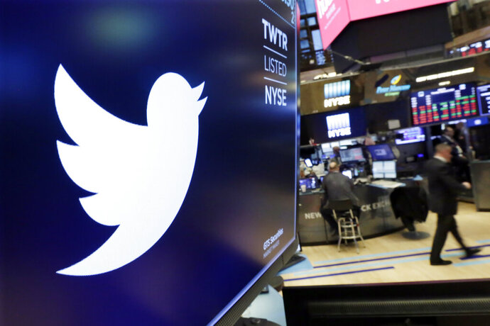 FILE - In this Feb. 8, 2018 file photo, the logo for Twitter is displayed above a trading post on the floor of the New York Stock Exchange.  In a policy published Friday, Nov. 15, 2019 Twitter said it is banning ads that contain references to political content, including appeals for votes, solicitations of financial support and advocacy for or against political content. The ban also includes any ads by candidates, political parties, elected or appointed government officials. (AP Photo/Richard Drew, File)