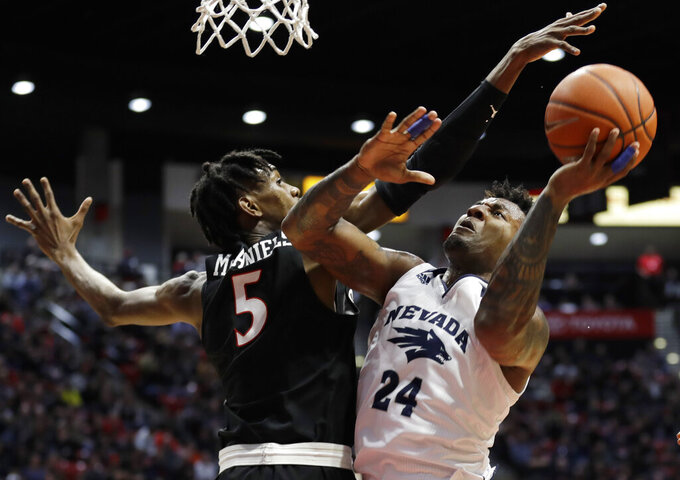 Nevada forward Jordan Caroline (24) shoots as San Diego State forward Jalen McDaniels (5) defends during the first half of an NCAA college basketball game Wednesday, Feb. 20, 2019, in San Diego. (AP Photo/Gregory Bull)