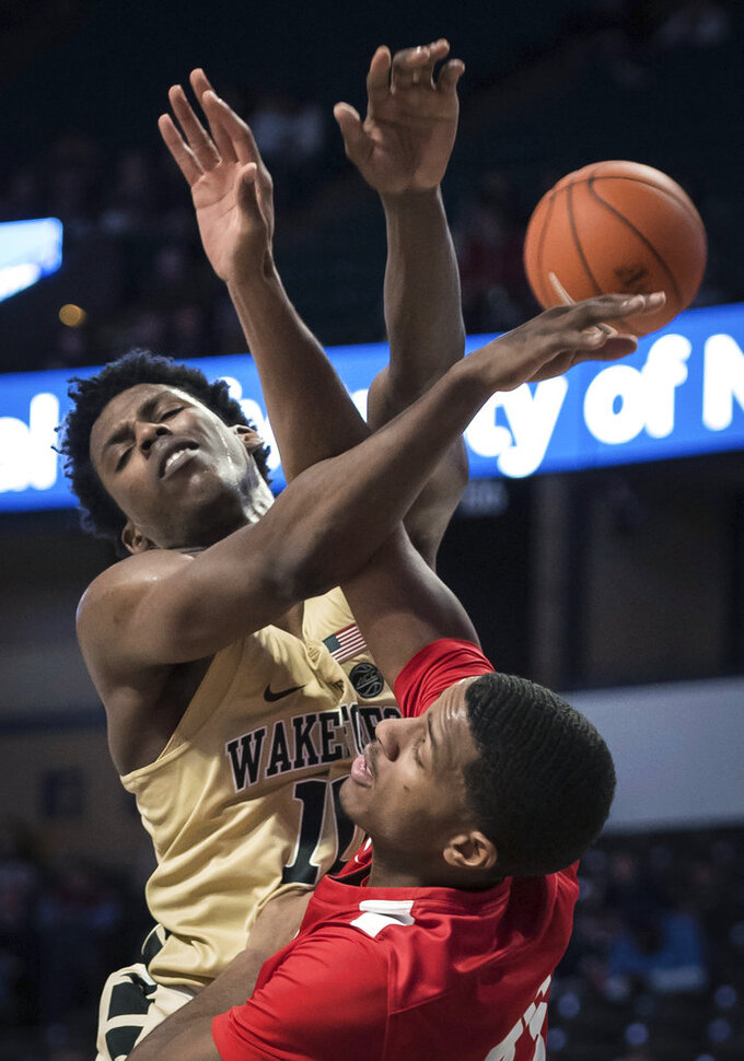 Wake Forest forward Jaylen Hoard (10) and Cornell forward Steven Julian (33) vie for a rebound  during the second half of an NCAA college basketball game Wednesday, Jan. 2, 2019, in Winston-Salem, N.C. (Allison Lee Isley/The Winston-Salem Journal via AP)