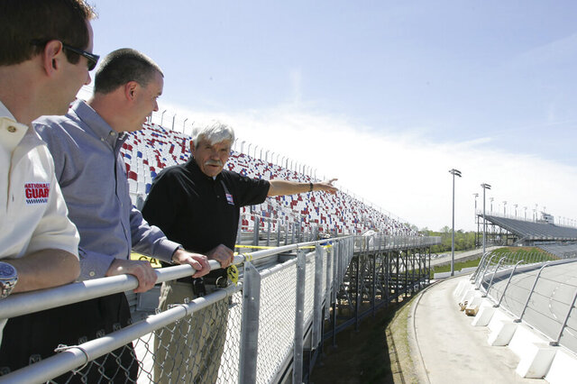 FILE - In this April 5, 2006, file photo, NASCAR driver Greg Biffle, left, Darlington Raceway President Chris Browning, center, and Harold Brasington Jr. look out over Darlington Raceway in Darlington, S.C. Brasington Jr.'s father was the track builder. The 70-year-old raceway will host the return of NASCAR Cup Series racing, among the biggest events so far as sports makes a halting comeback from a global shutdown forced by the coronavirus pandemic. (John D. Russell/The Morning News via AP, File)