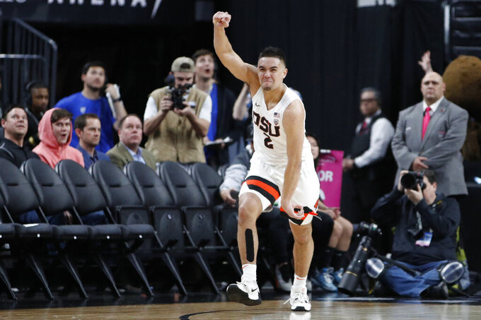 Oregon State's Jarod Lucas (2) celebrates after making a 3-point shot against Utah with seconds left during the second half of an NCAA college basketball game in the first round of the Pac-12 men's tournament Wednesday, March 11, 2020, in Las Vegas. (AP Photo/John Locher)