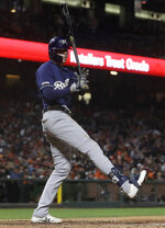Milwaukee Brewers' Christian Yelich strikes out against the San Francisco Giants during the ninth inning of a baseball game in San Francisco, Friday, June 14, 2019. (AP Photo/Jeff Chiu)