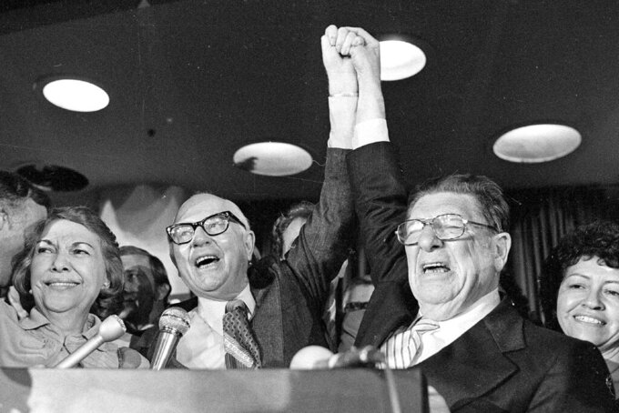FILE - In this June 7, 1978 file photo, Paul Gann, left, and Howard Jarvis, right, celebrate as their co-authored tax initiative Proposition 13 takes a commanding lead and ultimately won in the California primary in Los Angeles. California Gov. Gavin Newsom announced Monday, May 10, 2021, he plans to send money back to most state taxpayers because the state is projected to exceed a voter-approved limit on appropriations for only the second time ever. The limit is named after Paul Gann, a conservative activist who died in 1989 who campaigned for the limit. (AP Photo/File)
