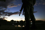 A Mexican National Guard patrols near the bridge that crosses the Suchiate River, on the border with Guatemala, near Ciudad Hidalgo, Mexico, Friday, Jan. 17, 2020. United States officials are crediting tough measures taken over the past year and cooperation from regional governments for sharply reducing the number of Central American migrants who responded to a call for a new caravan. (AP Photo/Marco Ugarte)