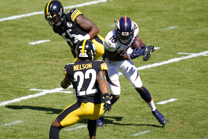 Denver Broncos wide receiver Jerry Jeudy (10) is hit by Pittsburgh Steelers linebacker Devin Bush (55) during the first half of an NFL football game against the Pittsburgh Steelers, Sunday, Sept. 20, 2020, in Pittsburgh. Judy was injured on the play. (AP Photo/Keith Srakocic)