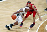 Michigan State's Cassius Winston, left, drives against Rutgers' Caleb McConnell during the first half of an NCAA college basketball game, Sunday, Dec. 8, 2019, in East Lansing, Mich. (AP Photo/Al Goldis)