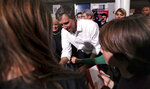 Former Texas congressman Beto O'Rourke signs autographs during a campaign stop at Keene State College in Keene, N.H., Tuesday, March 19, 2019. O'Rourke announced last week that he'll seek the 2020 Democratic presidential nomination. (AP Photo/Charles Krupa)