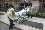 FILE —In this April 17, 2020, file photo, a patient is prepared to be loaded into the back of an ambulance by emergency medical workers outside Cobble Hill Health Center in the Brooklyn borough of New York. Cuomo also ordered nursing homes to accept recovering coronavirus patients to free up hospital beds, a move since blamed for the rapid spread of the disease in those facilities. More than 6,400 people have died of coronavirus in New York nursing homes, and the policy was later rescinded — though state officials argued it was employees who were causing the outbreaks. (AP Photo/John Minchillo, File)