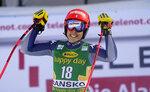Italy's Federica Brignone celebrates at the finish line during an alpine ski, women's World Cup downhill, in Bansko, Bulgaria, Friday, Jan. 24, 2020. (AP Photo/Giovanni Auletta)