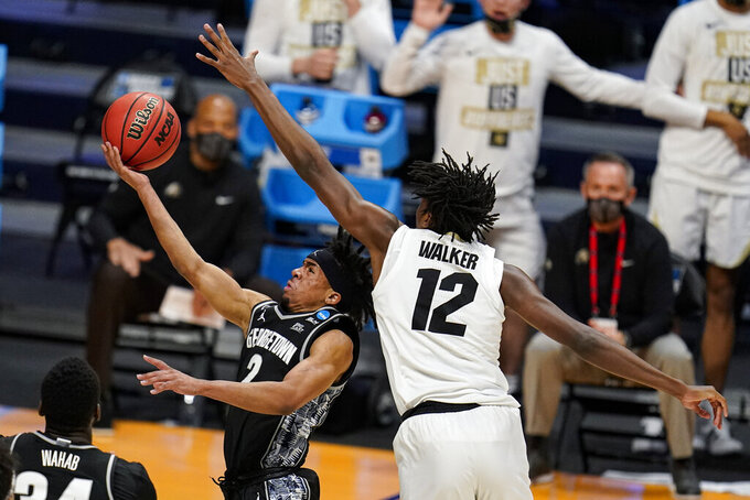 Georgetown guard Dante Harris (2) shoots in front of Colorado forward Jabari Walker (12) in the first half of a first-round game in the NCAA men's college basketball tournament at Hinkle Fieldhouse in Indianapolis, Saturday, March 20, 2021. (AP Photo/Michael Conroy)