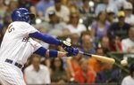 Milwaukee Brewers' Mike Moustakas hits a ground ball that scores Christian Yelich from third during the ninth inning of a baseball game against the San Francisco Giants Friday, July 12, 2019, in Milwaukee. (AP Photo/Morry Gash)