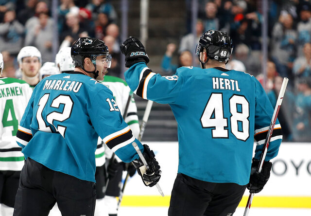 San Jose Sharks center Tomas Hertl (48) congratulates Patrick Marleau (12), who scored a goal against the Dallas Stars during the second period of an NHL hockey game in San Jose, Calif., Saturday, Jan. 11, 2020. (AP Photo/Josie Lepe)