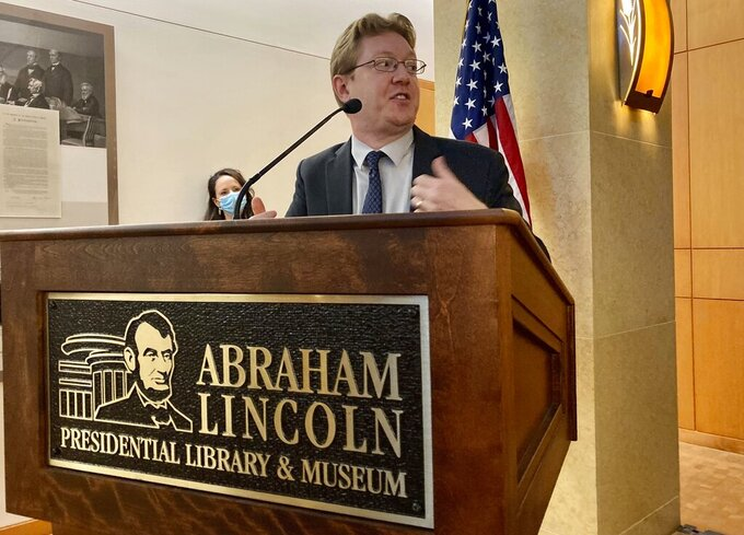 Christian McWhirter, Lincoln historian at the Abraham Lincoln Presidential Library and Museum addresses the importance of the desk that Abraham Lincoln used to draft the presidential inaugural address Thursday, Sept. 16, 2021 in Springfield, Ill.. The desk that Abraham Lincoln used to draft the presidential inaugural address he delivered on March 4, 1861, on the eve of the Civil War, is on display free to the public. Lincoln needed a quiet place away from well-wishers to write the speech, and his brother-in-law, Clark Moulton Smith, offered him a third-floor storage room in the store he owned on the state Capitol square in downtown Springfield. The state purchased the desk from the Smith family in 1953 and this summer spent $6,300 to have it historically restored and repaired. (AP Photo/John O'Connor)