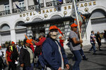 Striking municipal workers protest in central Athens against government plans to expand private sector involvement in municipal services, on Thursday, Oct. 24, 2019. Municipal workers have launched a series of strikes this week that are causing garbage to pile up on the streets. (AP Photo/Petros Giannakouris)