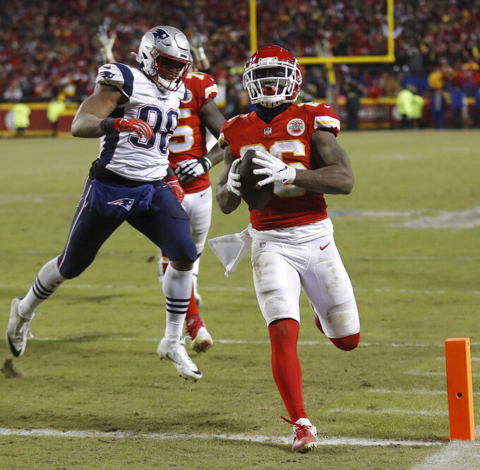 Kansas City Chiefs running back Damien Williams (26) runs to the end zone for a touchdown during the second half of the AFC Championship NFL football game against the New England Patriots, Sunday, Jan. 20, 2019, in Kansas City, Mo. (AP Photo/Charlie Neibergall)