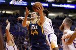 Utah Jazz forward Bojan Bogdanovic (44) shoots against the Phoenix Suns during the first half of an NBA basketball game, Monday, Oct. 28, 2019, in Phoenix. (AP Photo/Matt York)