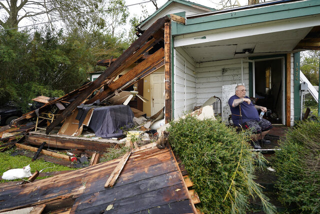 Chris Johnson views destruction at his home on Thursday, Aug. 27, 2020, in Lake Charles, La., after Hurricane Laura moved through the state. Johnson stayed in his home as the storm passed. (AP Photo/Gerald Herbert)