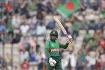 Bangladesh's Mushfiqur Rahim celebrates reaching 50 runs during the Cricket World Cup match between Bangladesh and Afghanistan at the Hampshire Bowl in Southampton, England, Monday, June 24, 2019. (AP Photo/Matt Dunham)