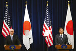 U.S. Vice President Mike Pence, left, and Japanese Prime Minister Shinzo Abe read a joint statement at Abe's official residence in Tokyo Tuesday, Nov. 13, 2018. (AP Photo/Eugene Hoshiko)