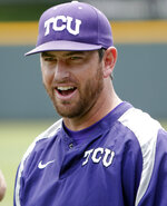 File-This May 28, 2014, file photo shows TCU assistant coach Kirk Saarloos watching as players warm up at practice in Fort Worth, Texas.  Former big league pitcher Saarloos was named TCU's new head baseball coach Tuesday, June 15, 2021, after nine seasons as the team's pitching coach that included four consecutive trips to the College World Series. Saarloos replaces Jim Schlossnagle, who left after 18 seasons last week to become Texas A&M's coach. (Brandon Wade /Star-Telegram via AP, File)