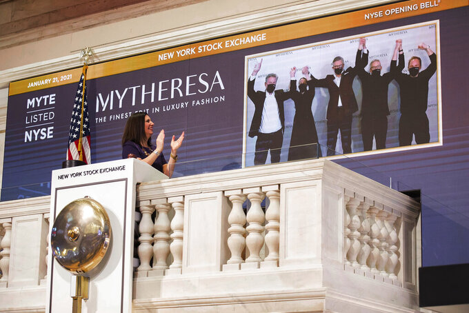 Stacey Cunningham, NYSE President, applauds as Michael Kliger, CEO, Mytheresa virtually rings the opening bell at the New York Stock Exchange on Thursday, Jan. 21, 2021. (Courtney Crow/New York Stock Exchange via AP)