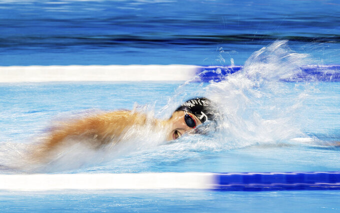 Katie Ledecky swims the women's 1,500-meter freestyle during Wave 2 of the U.S. Olympic Swim Trials on Wednesday, June 16, 2021, in Omaha, Neb. (Chris Machian/Omaha World-Herald via AP)