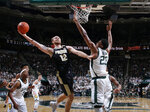 Purdue's Evan Boudreaux (12) shoots against Michigan State's Xavier Tillman (23) during the first half of an NCAA college basketball game Tuesday, Jan. 8, 2019, in East Lansing, Mich. Michigan State won 77-59. (AP Photo/Al Goldis)
