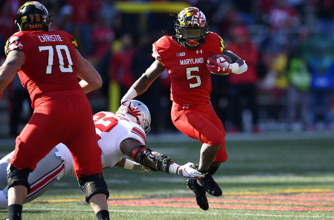 FILE - In this Nov. 17, 2018, file photo, Maryland running back Anthony McFarland (5) runs the ball against Ohio State defensive tackle Haskell Garrett (92) during the first half of an NCAA football game, in College Park, Md. One year ago, Maryland took Ohio State into overtime before a failed 2-point conversion resulted in a 52-51 defeat. McFarland Jr. enjoyed the finest day of his career in that back-and-forth duel with the then-No.9 Buckeyes. In the rematch Saturday, the Terrapins are a 43-point underdog. (AP Photo/Nick Wass, File)