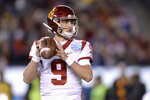 Southern California quarterback Kedon Slovis looks to pass during the first half of the Holiday Bowl NCAA college football game against Iowa, Friday, Dec. 27, 2019, in San Diego. (AP Photo/Orlando Ramirez)