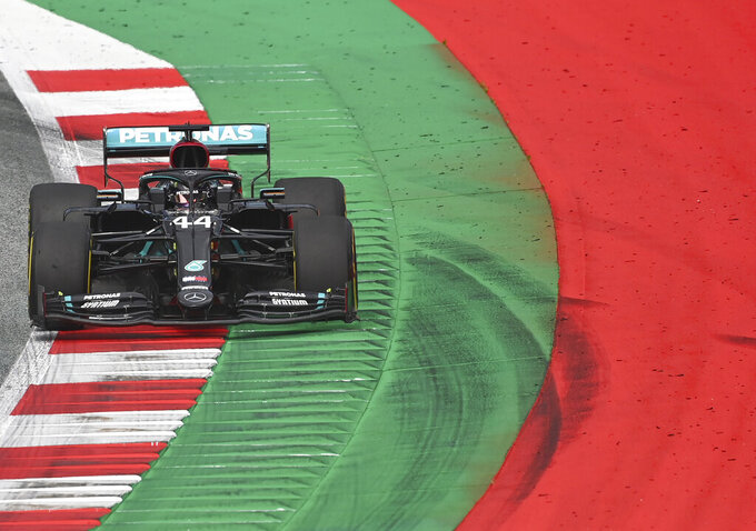 Mercedes driver Lewis Hamilton of Britain steers his car during the second practice session at the Red Bull Ring racetrack in Spielberg, Austria, Friday, July 3, 2020. The Austrian Formula One Grand Prix will be held on Sunday. (Joe Klamar/Pool via AP)