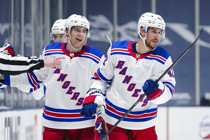 New York Rangers' Brendan Smith, right, and Libor Hajek, left, celebrates after Smith scored a goal during the second period of an NHL hockey game against the New York Islanders Sunday, April 11, 2021, in Uniondale, N.Y. (AP Photo/Frank Franklin II)