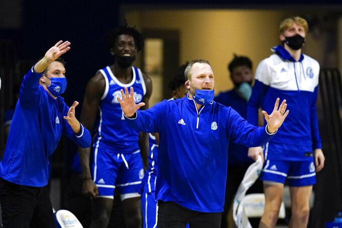 Drake head coach Darian DeVries directs his team during overtime in an NCAA college basketball game against Loyola of Chicago, Sunday, Feb. 14, 2021, in Des Moines, Iowa. Drake won 51-50 in overtime. (AP Photo/Charlie Neibergall)