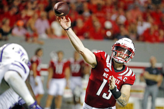 North Carolina State's Devin Leary (13) passes the ball against Furman during the first half of an NCAA college football game in Raleigh, N.C., Saturday, Sept. 18, 2021. (AP Photo/Karl B DeBlaker)