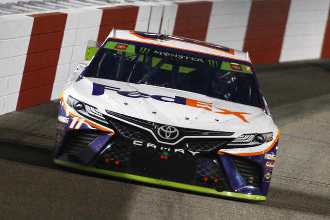 Denny Hamlin (11) drives into turn one during the NASCAR Monster Energy Cup series auto race at Richmond Raceway in Richmond, Va., Saturday, Sept. 21, 2019. (AP Photo/Steve Helber)