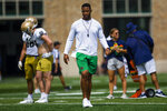 Offensive coordinator Marcus Freeman watches Notre Dame NCAA college football practice in South Bend, Ind., Thursday, Aug. 12, 2021. (Michael Caterina/South Bend Tribune via AP)