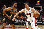 Miami Heat guard Goran Dragic (7) dribbles against Atlanta Hawks forward Jabari Parker (5) during the second half of an NBA preseason basketball game Monday, Oct. 14, 2019, in Miami. (AP Photo/Brynn Anderson)