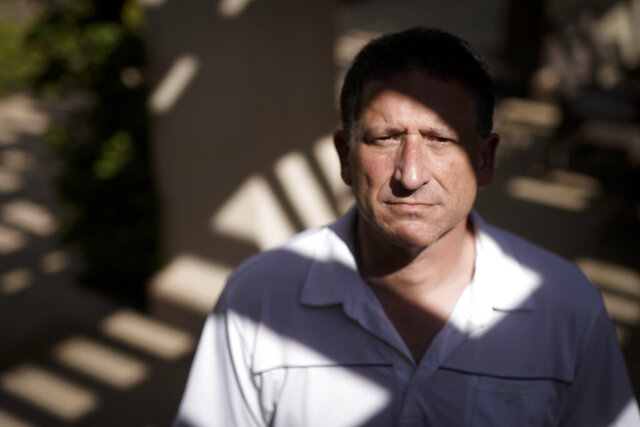 Keith Gartenlaub poses for a pictures near his home Wednesday, March 11, 2020, in Irvine, Calif. A former Boeing engineer, Gartenlaub, who was targeted with a FISA warrant because agents suspected him of having provided the designs of a C-17 transport plane to China. (AP Photo/Chris Carlson)